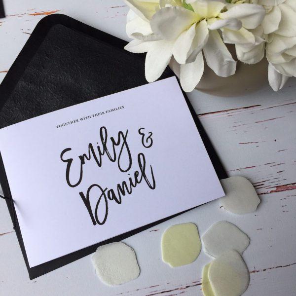 Wedding invitation with black envelopes